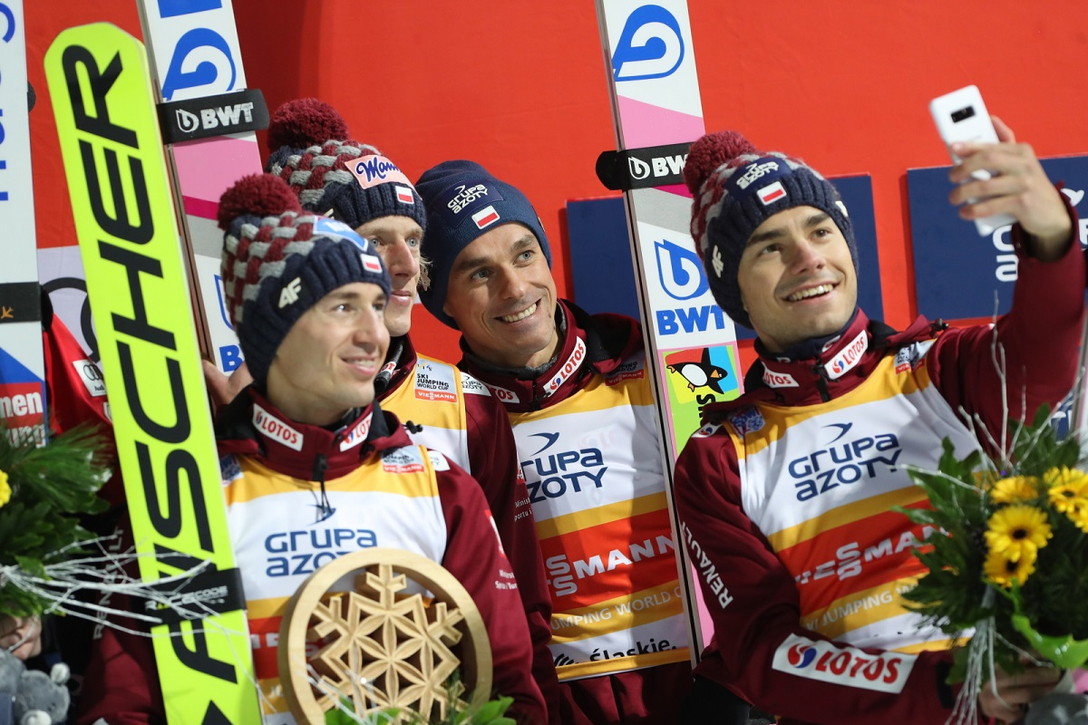 Polish ski jumpers Kamil Stoch, Dawid Kubacki, Piotr Żyła and Jakub Wolny celebrate finishing third in a season-opening World Cup team competition in Wisła, southern Poland, on Sunday. Photo: PAP/Grzegorz Momot
