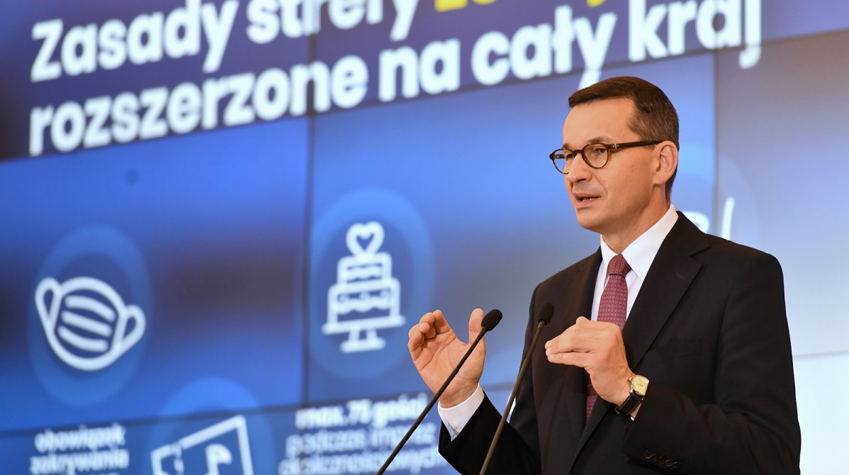 Prime Minister Mateusz Morawiecki announcing tougher sanitary rules at a press conference on Thursday.