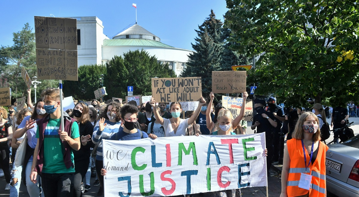 Protesters take to the streets of Warsaw on Friday, Sept. 25, 2020, to demand action on climate change.