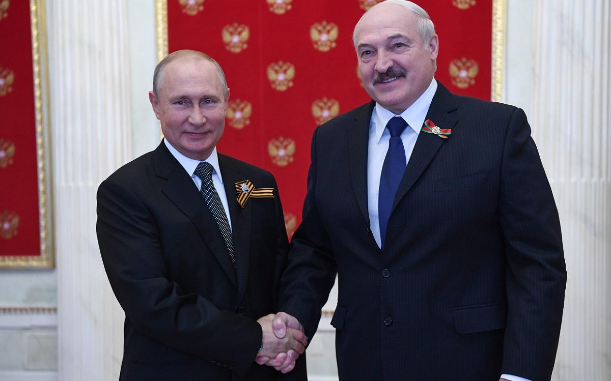 Russian President Vladimir Putin and Belarusian President Alexander Lukashenko shake hands as they meet in Moscow on June 24, 2020.