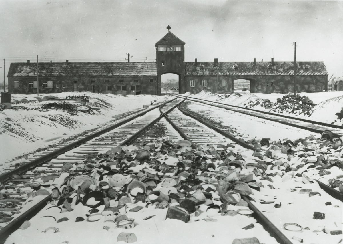A photo made available by the Auschwitz Memorial and Museum shows the unloading ramp and the Gate of Death at the former German Nazi concentration and extermination camp in southern Poland in the winter of 1945.