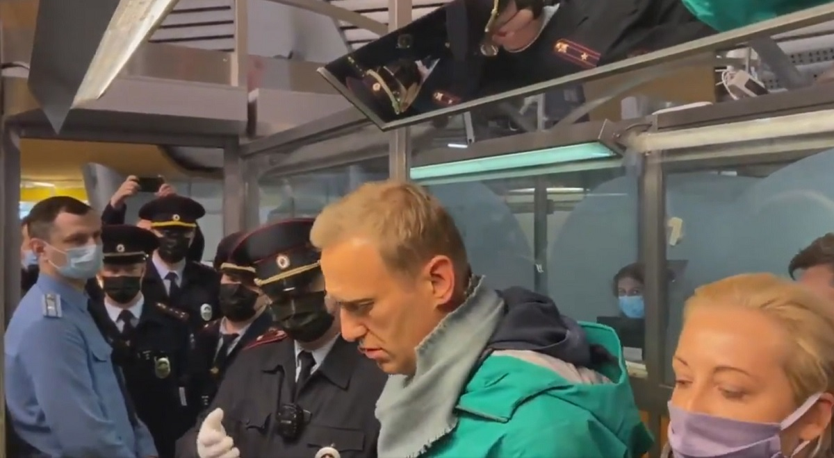 An image taken from video footage posted by Alexei Navalnys press secretary on Twitter showing the Kremlin critic (2nd right) during his detention at Sheremetyevo Airport in Moscow on Sunday, Jan. 17, 2021.