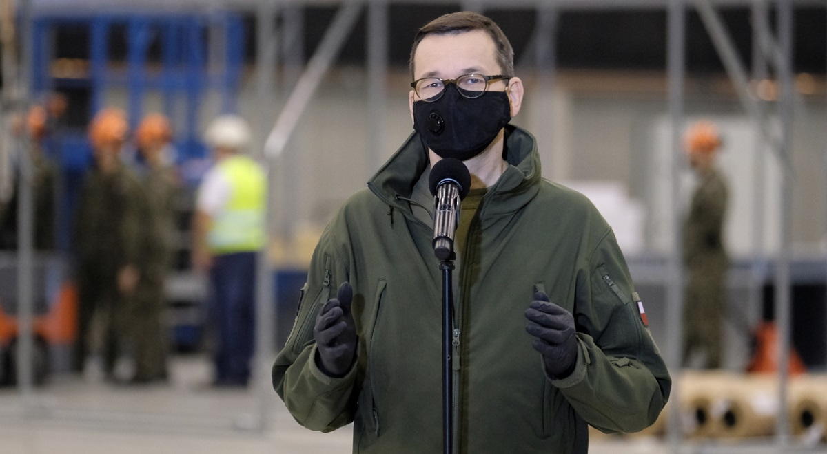 Polands Prime Minister Mateusz Morawiecki speaks during a visit on Saturday to the southern city of Katowice where a temporary hospital is being built for coronavirus patients.