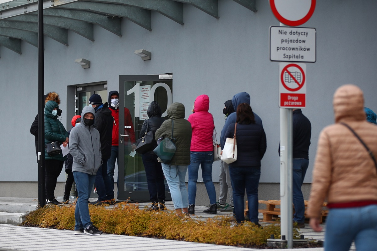 People line up to be tested for coronavirus at a hospital in the southern Polish city of Kraków.