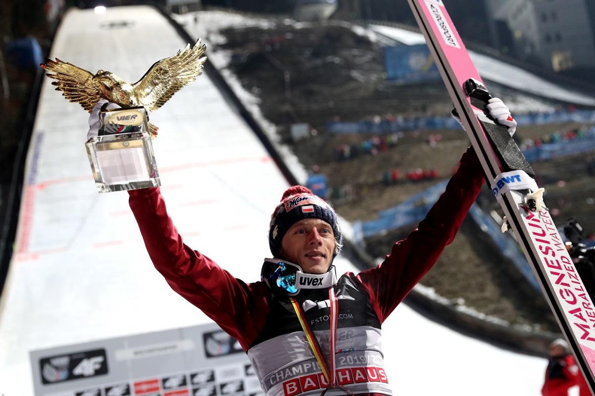 Polish ski jumper Dawid Kubacki poses with his trophy as the overall winner of the 68th Four Hills Tournament, in Bischofshofen, Austria, on Monday. Photo: EPA/RONALD WITTEK
