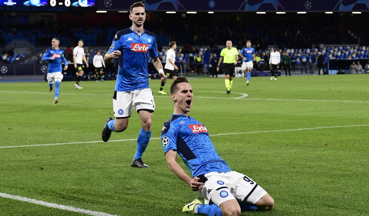 Arkadiusz Milik (right) celebrates after scoring the 1-0 lead during the UEFA Champions League Group E game between Napoli and Genk in Naples