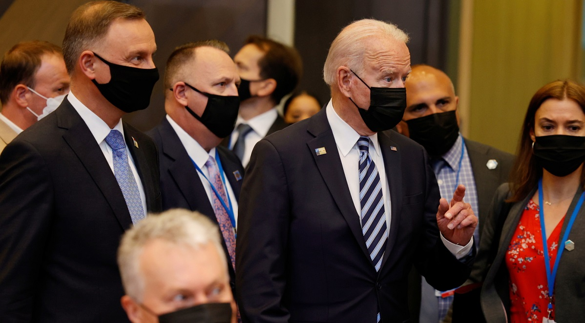 US President Joe Biden (centre) and Polands Andrzej Duda (left) arrive for a plenary session at a NATO summit in Brussels on Monday.