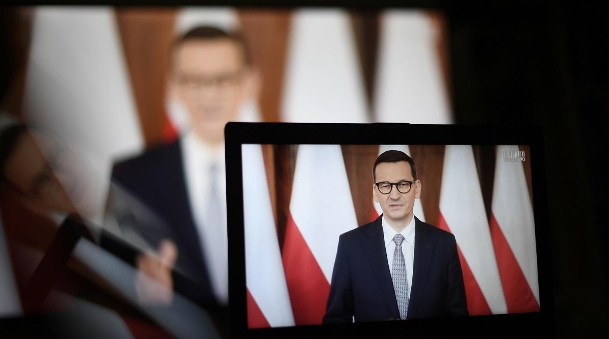 PM Mateusz Morawiecki seen on screen as he addresses a business forum on Thursday.
