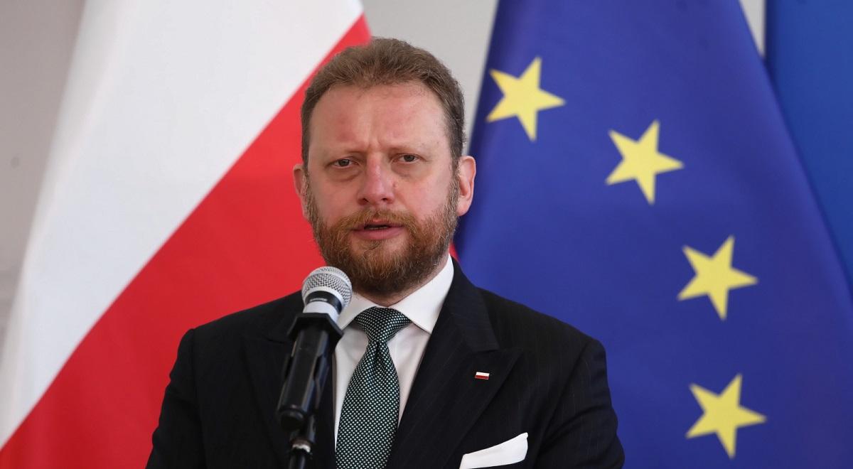 Polands Health Minister Łukasz Szumowski briefs reporters on Friday.