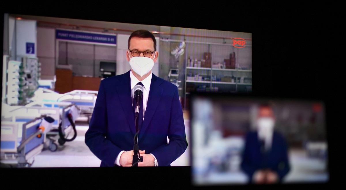 Poland's Prime Minister Mateusz Morawiecki seen on a screen during a virtual media briefing on Thursday.