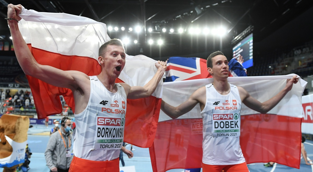 Polands Patryk Dobek (right) and Mateusz Borkowski (left) celebrate winning the gold and silver respectively in the mens 800m at the European Athletics Indoor Championships in Toruń on Sunday, March 7, 2021.