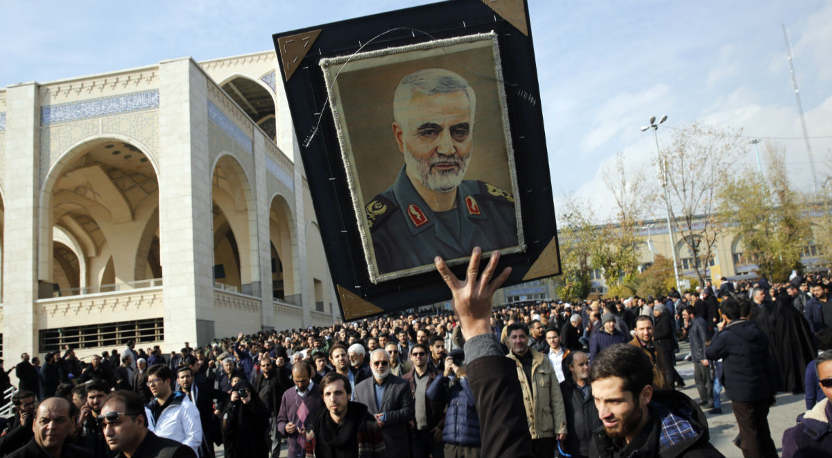 A person holds up a portrait of Iranian Revolutionary Guards Corps (IRGC) Lieutenant general and commander of the Quds Force Qasem Soleimani as thousands of Iranians take part in an anti-US demonstration to condemn the killing of Soleimani, after Friday prayers in Tehran, Iran, 03 January 2020. The Pentagon announced that Irans Quds Fo