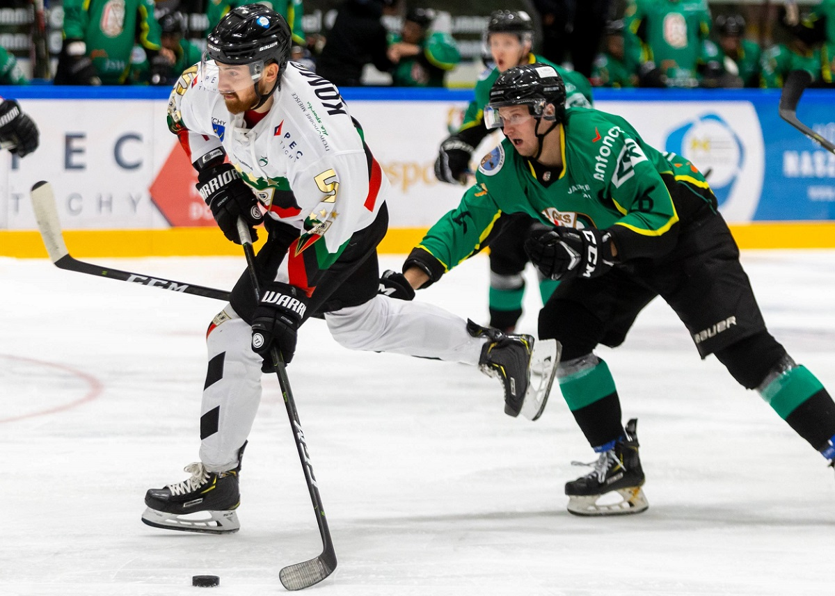 Polish ice hockey players Filip Komorski (left) and Arkadiusz Kostek (right) in action during a league match in October last year.