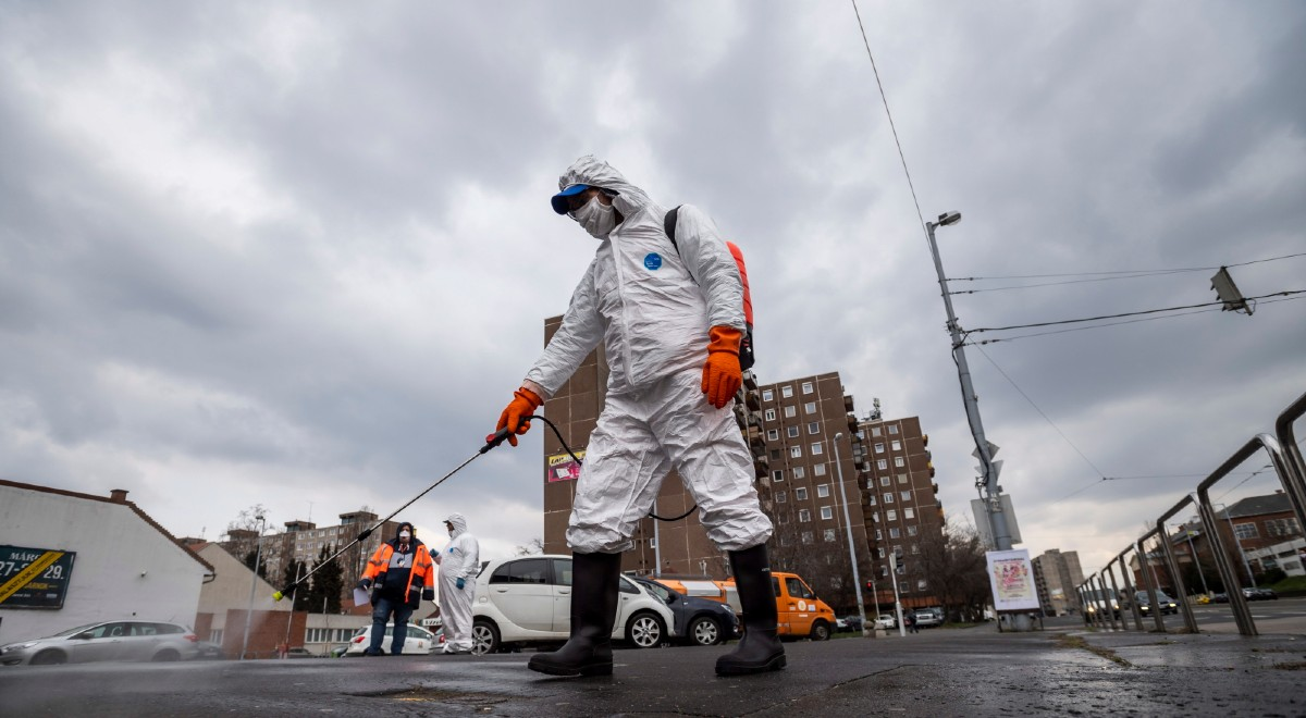 A municipal worker disinfects a street to prevent the spread of the coronavirus pandemic in Budapest, Hungary, 25 March 2020. Countries around the world are taking increased measures to stem the widespread of the SARS-CoV-2 coronavirus which causes the Covid-19 disease