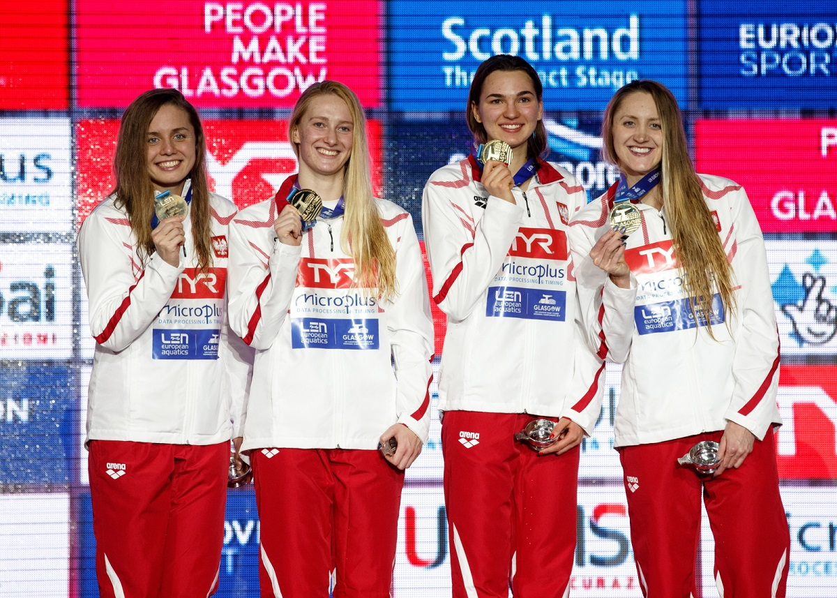 Polish swimmers celebrate on the podium after winning gold in the womens 4x50m medley event at the 2019 European Short-Course Swimming Championships in Glasgow on Sunday.