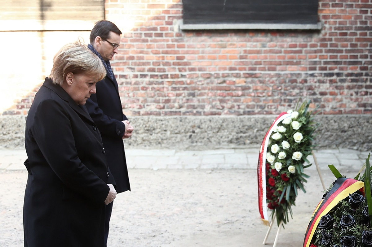 German Chancellor Angela Merkel and Polish Prime Minister Mateusz Morawiecki at the so-called Black Wall in Auschwitz.