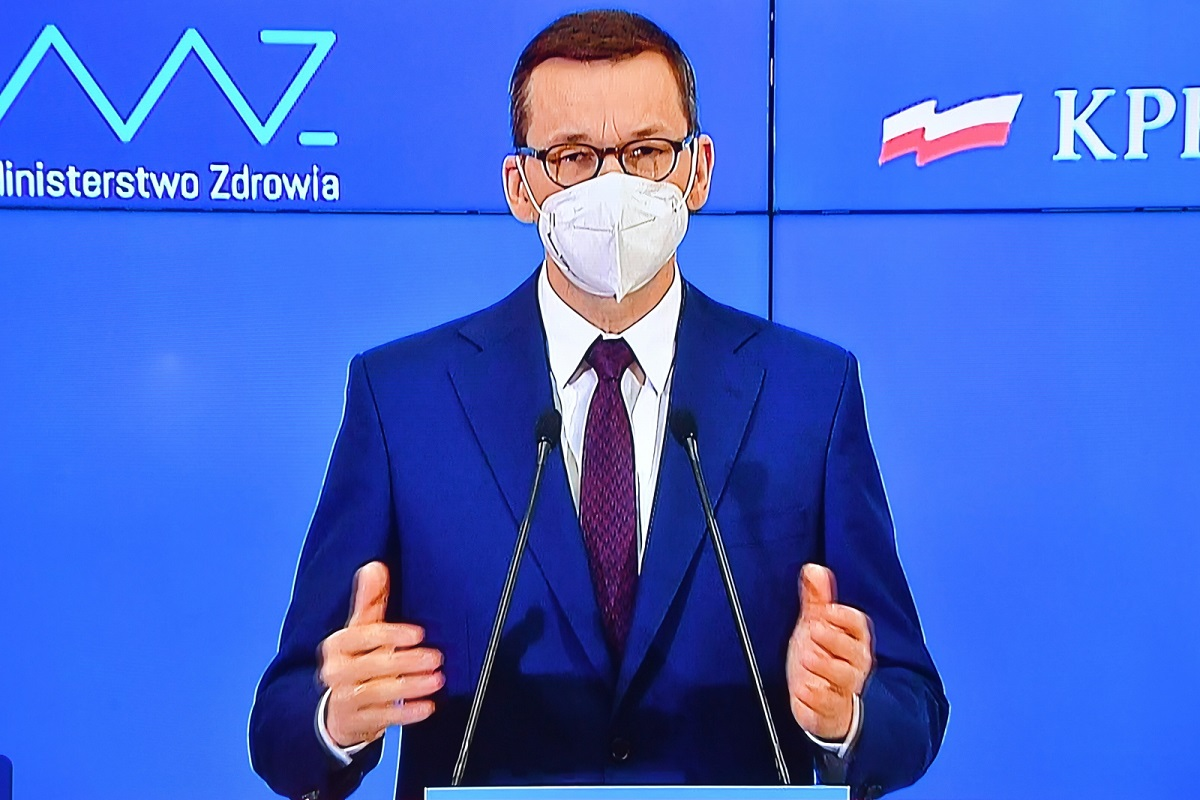Prime Minister Mateusz Morawiecki seen on a screen during a virtual news conference on Friday.