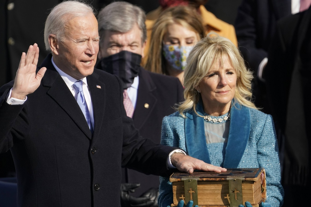 Joe Biden is sworn in as the 46th president of the United States by Chief Justice John Roberts as Jill Biden holds the Bible during the presidential Inauguration at the U.S. Capitol in Washington, on Wednesday, Jan. 20, 2021.