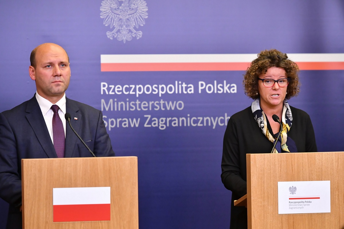 Polish Deputy Foreign Minister Szymon Szynkowski vel Sęk and spokeswoman Ewa Suwara hold a press conference after Neckermann Polska announces a plan to file for bankruptcy.