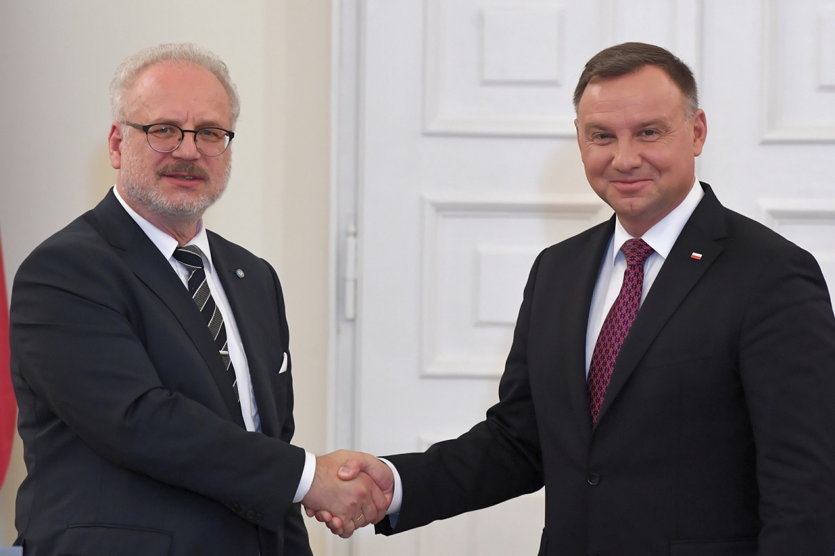 Polish President Andrzej Duda (right) and his Latvian counterpart Egils Levits (left) meet in Warsaw on Wednesday.
