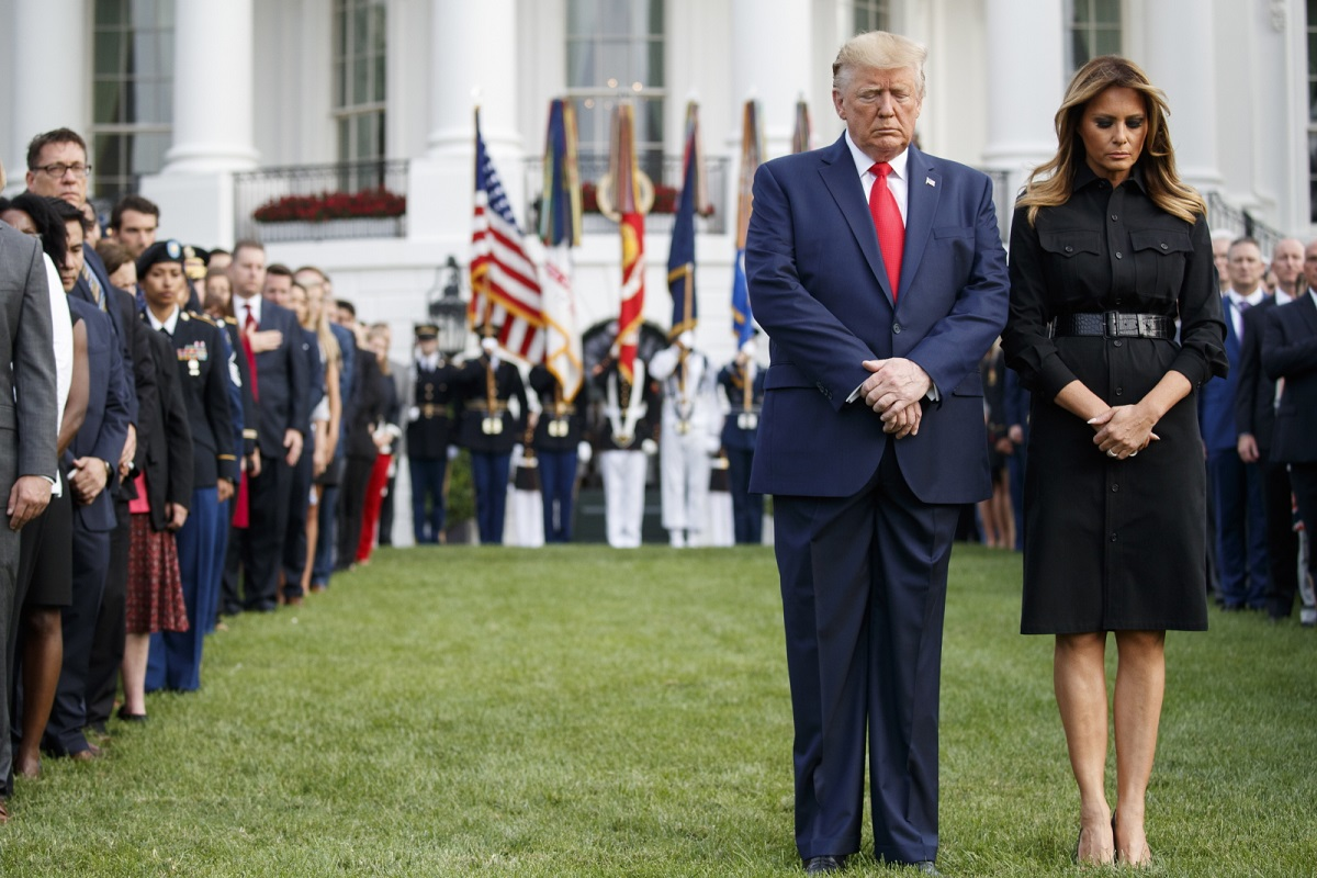 US President Donald Trump and First Lady Melania Trump observe a moment of silence on the 18th anniversary of the 911 terrorist attacks at the White House in Washington, DC, on Wednesday.