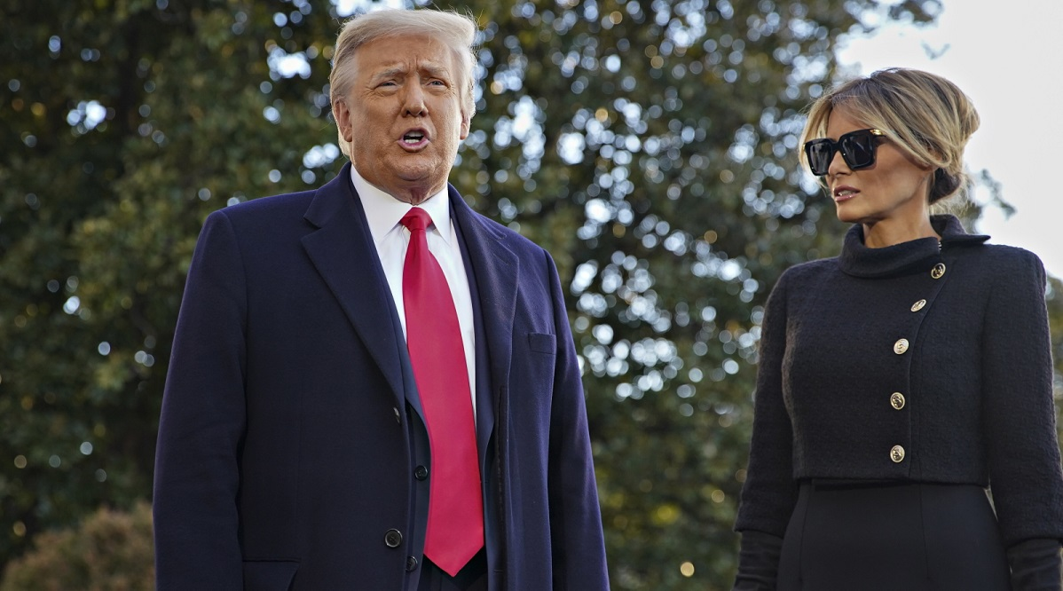 US President Donald Trump and First Lady Melania Trump exit the White House for the last time on the morning of the US presidential inauguration.