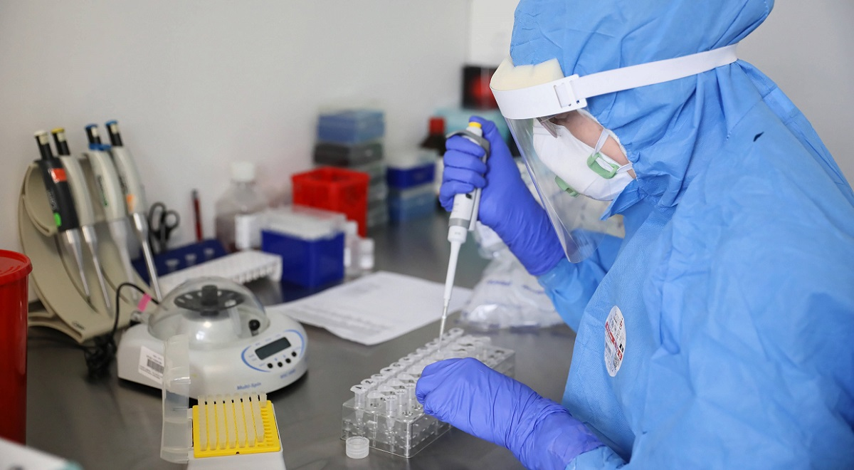 Coronavirus in Poland: A laboratory technician tests samples for COVID-19 at a Warsaw hospital.