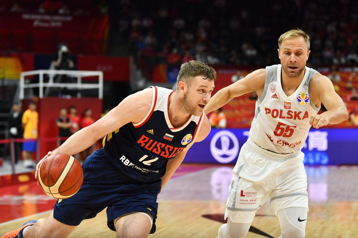 Poland's Łukasz Koszarek (right) in action against Russia's Andrey Zubkov (left) during the game in Foshan, China, on Friday.