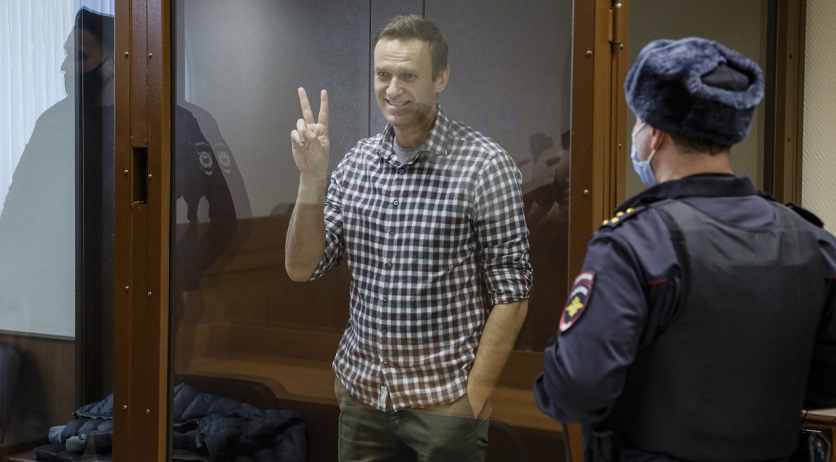 Russian opposition leader Alexei Navalny inside a glass cage prior to a hearing at a district court in Moscow on Feb. 20.