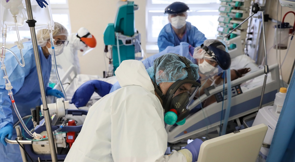 Medical professionals take care of a COVID-19 patient at the Polish interior ministrys Central Clinical Hospital in Warsaw.