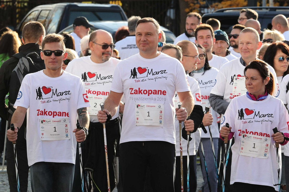 President Andrzej Duda (centre) takes part in a Nordic walking march in Zakopane, southern Poland, on Saturday.