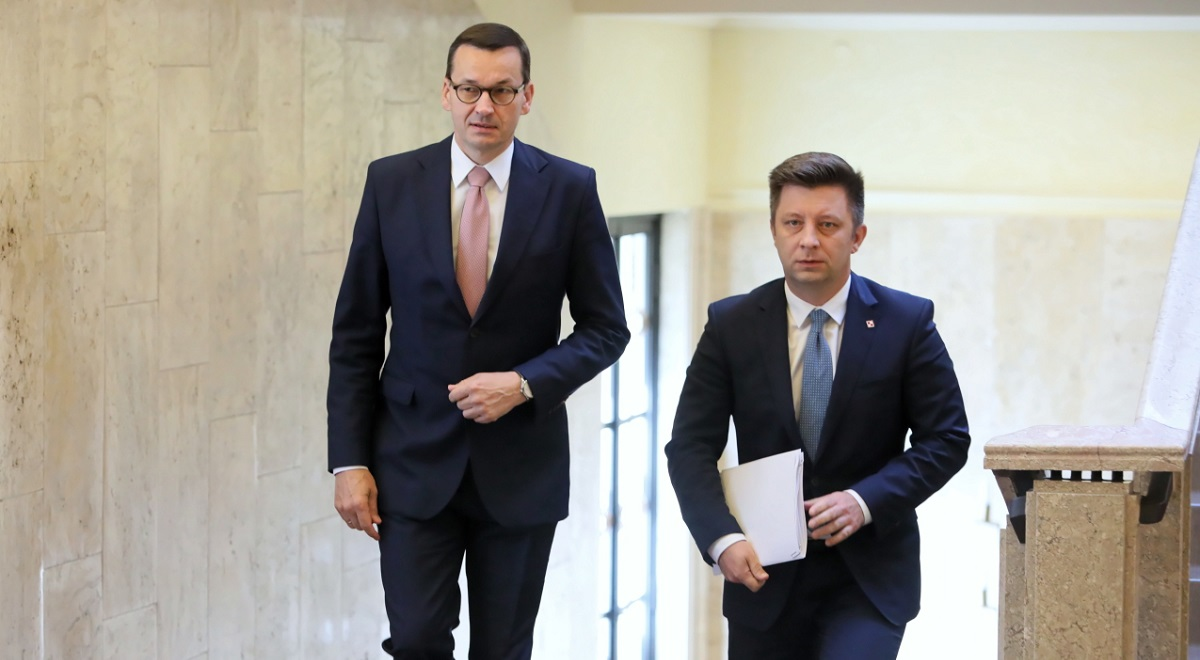 Polish Prime Minister Mateusz Morawiecki (left) and his chief of staff Michał Dworczyk (right).