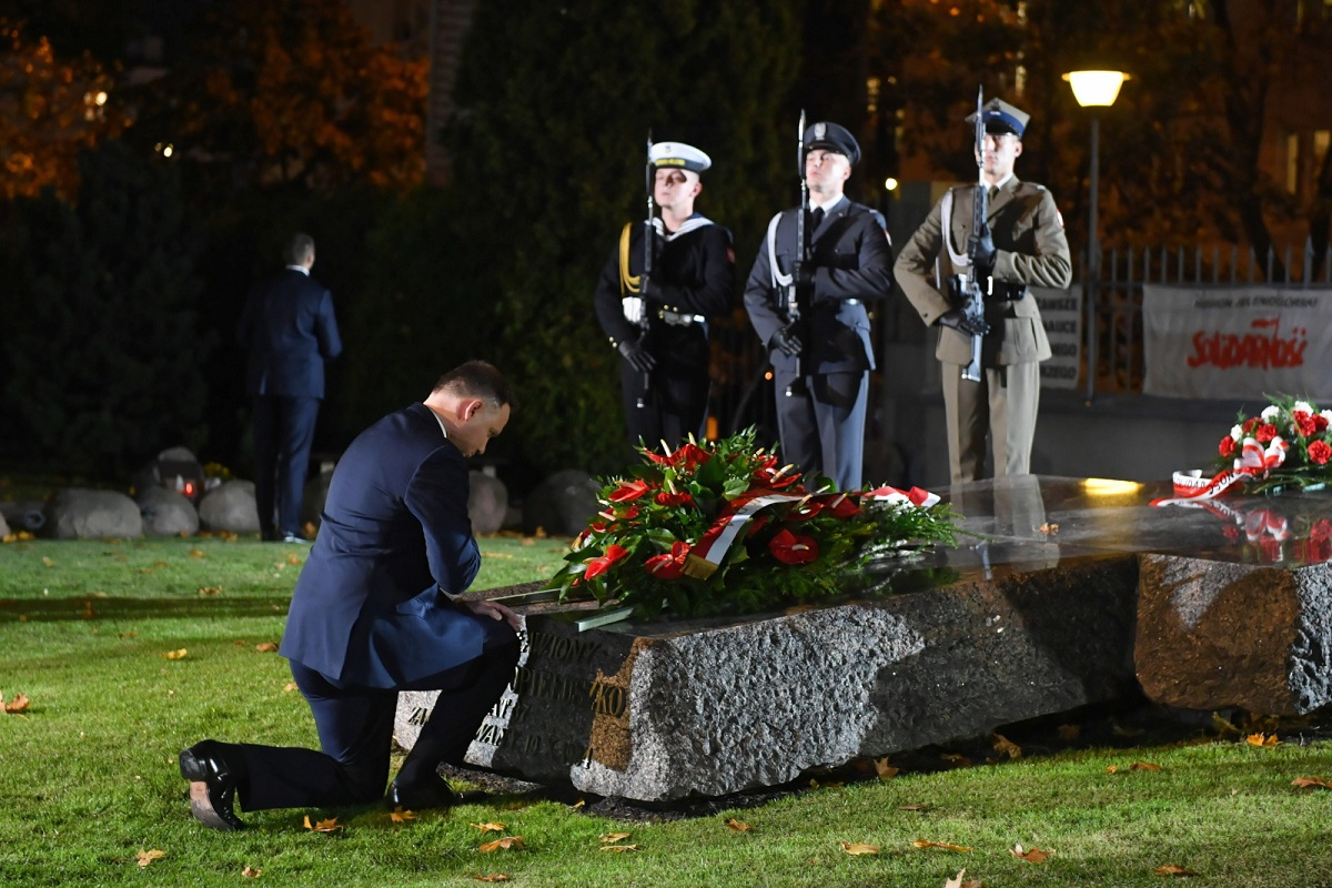 President Andrzej Duda lays a wreath at the grave of the Blessed Father Jerzy Popiełuszko in Warsaw on Friday.