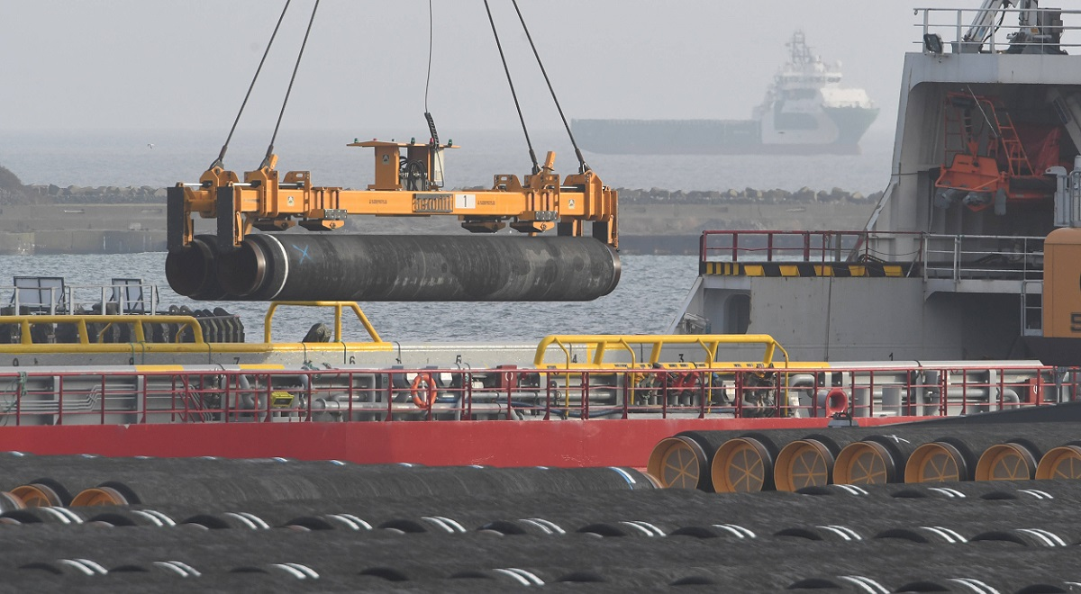 Cranes load pipes for the construction of the Nord Stream 2 Baltic Sea gas pipeline onto a ship at the German port of Mukran in December.