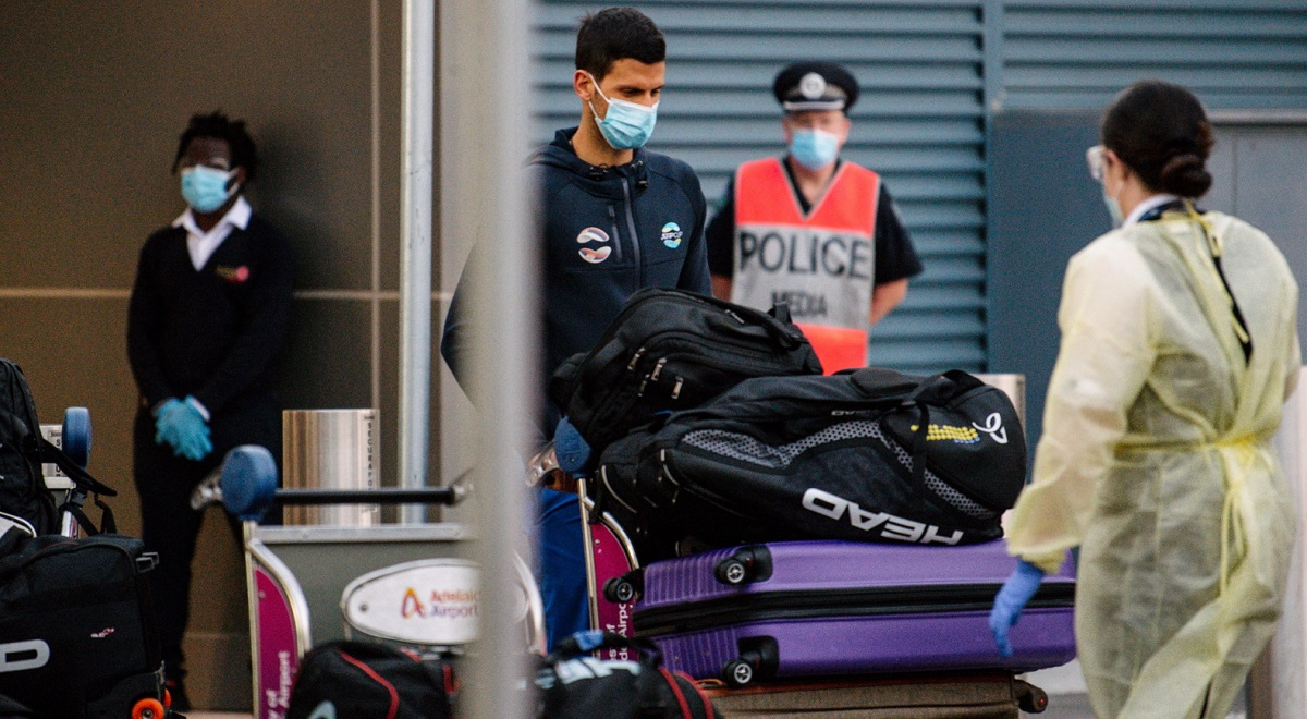 Serbia's world No. 1 Novak Djokovic arrives at Adelaide Airport ahead of the Australian Open, Jan. 14, 2021. Arriving players are required to serve a 14-day quarantine period ahead of the Grand Slam tournament, which is set to run in Melbourne from February 8 to 21.