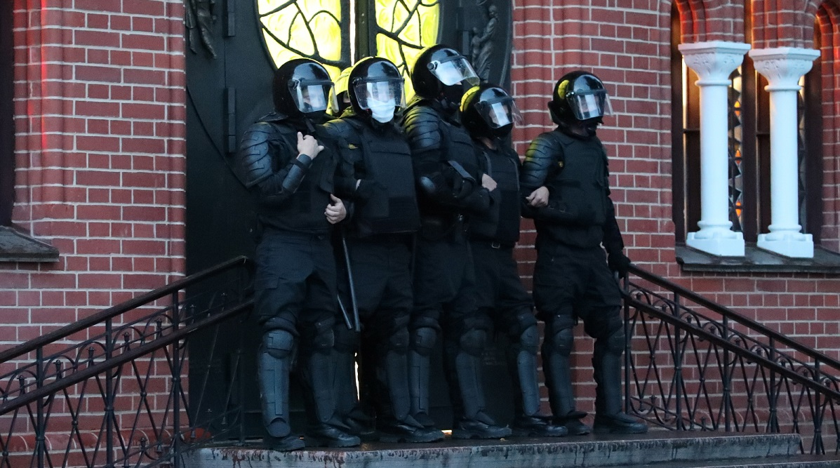 Police block the entrance of a church in Minsk where protesters have hidden during a protest rally against the results of the Belarus presidential elections, August 26.