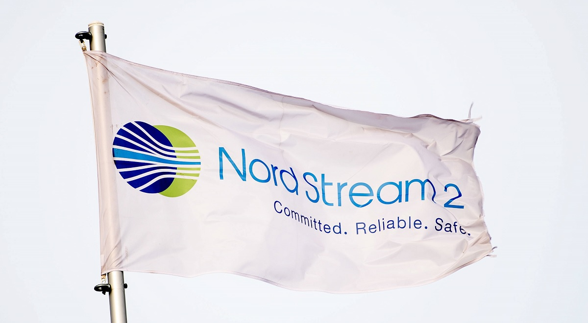 A flag reading Nord Stream 2 on the construction site of the Nord Stream 2 in Lubmin, Germany, 26 March 2019.