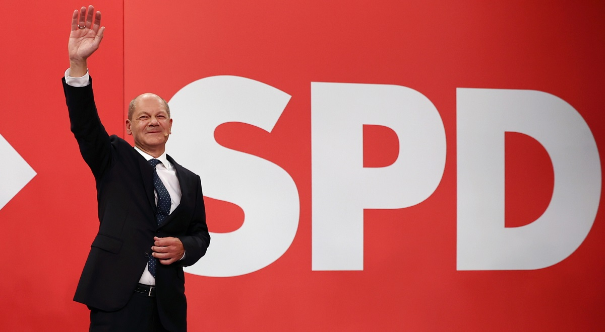 The German Social Democrats' (SPD) candidate for chancellor, Olaf Scholz, waves to supporters on election night in Berlin.