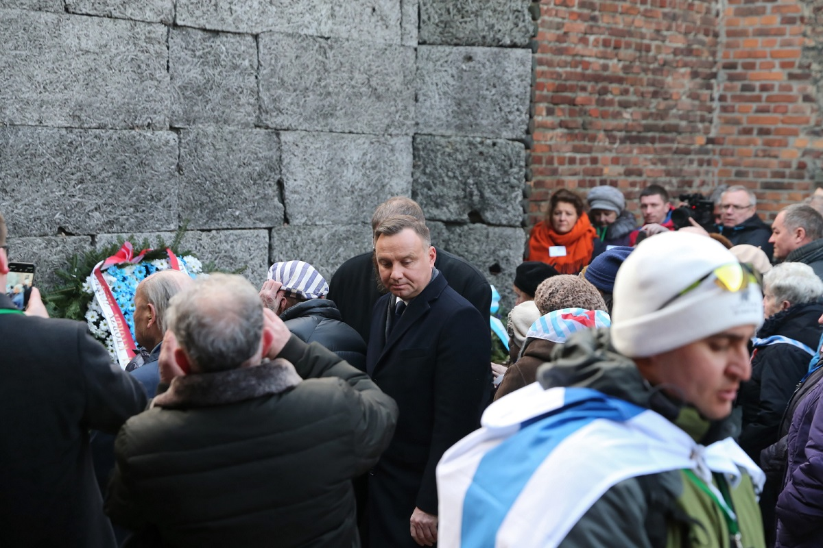 Polish President Andrzej Duda (centre) attends a wreath-laying ceremony at the Death Wall in the former Nazi German concentration and extermination camp of Auschwitz-Birkenau in southern Poland on Monday morning.