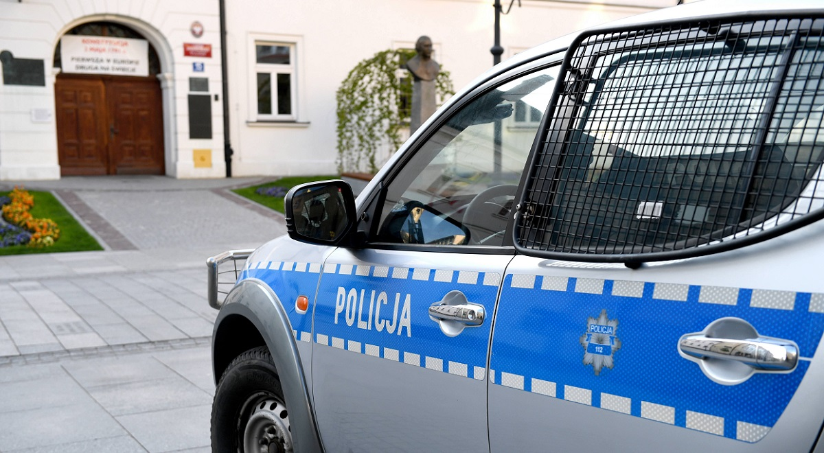 A police car is parked outside a high school in Rzeszów, southeastern Poland, after a bomb alert during key exams in May last year.