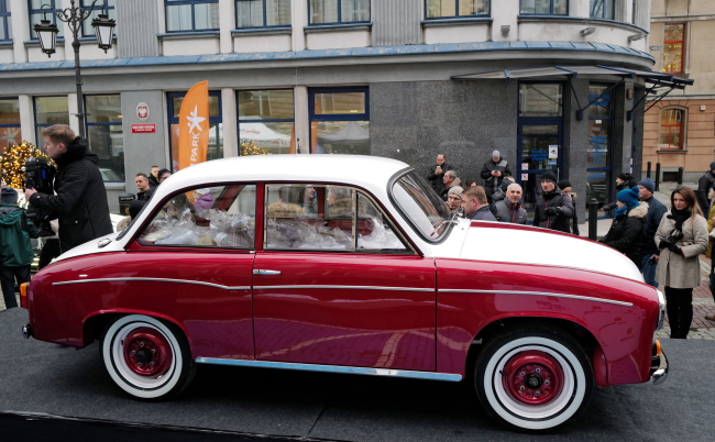 The vintage Syrena 105 belonging to American actor Tom Hanks on the Town Hall Square in Bielsko-Biała, southern Poland, 2 December 2019. Tom Hanks bought this Polish car, had it renovated and put it up for auction. The money from the auction will be allocated to help a childrens hospital in Bielsko-Biała.
