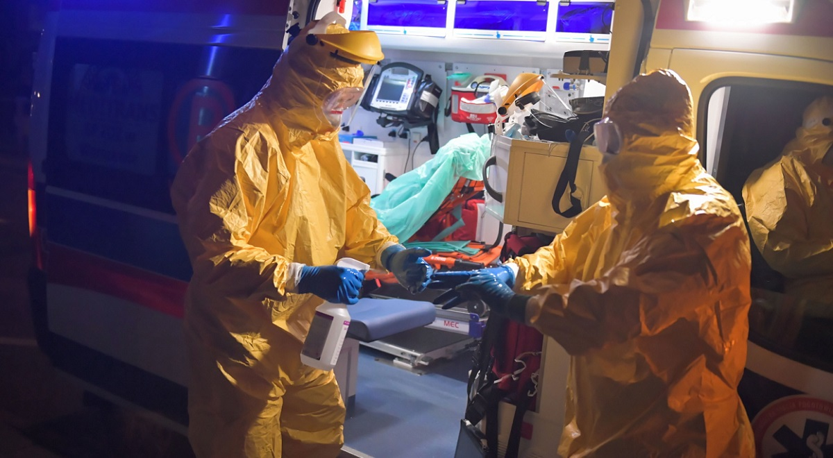 Paramedics transport a patient suspected of being infected with the coronavirus to a hospital in Warsaw.