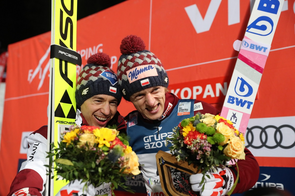 Polands Kamil Stoch and Dawid Kubacki celebrate during the victory ceremony for a ski-jumping competition in the southern Polish mountain resort of Zakopane on Sunday.