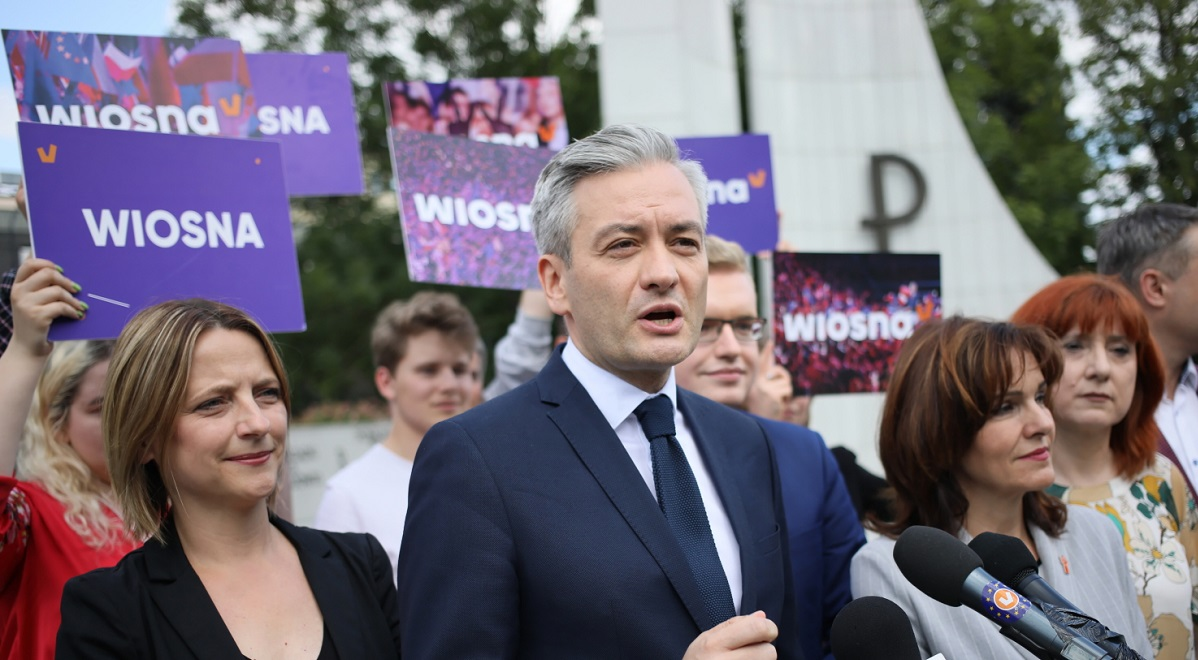 Robert Biedroń, leader of the Spring (Wiosna) party, talks to newsmen in front of the houses of parliament in Warsaw.
