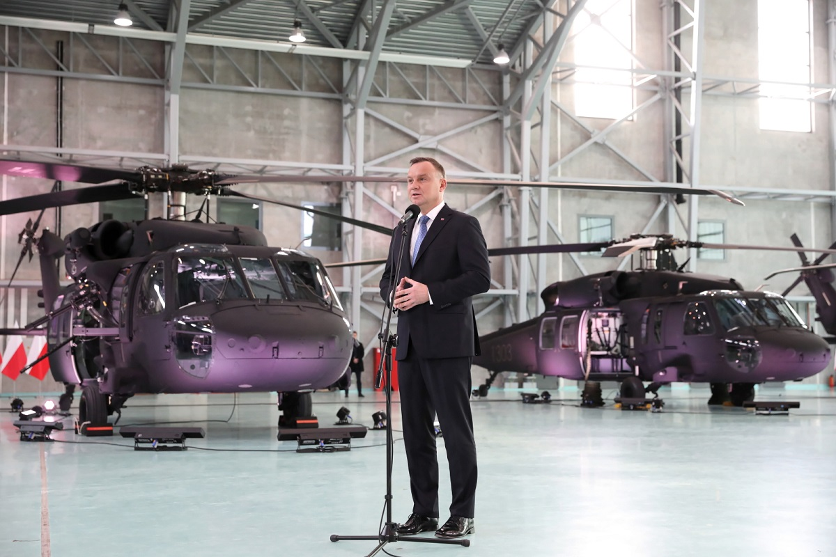 President Andrzej Duda speaks as four American-designed S-70i Black Hawk helicopters are handed over to Polands special forces at a ceremony in Warsaw on Friday.