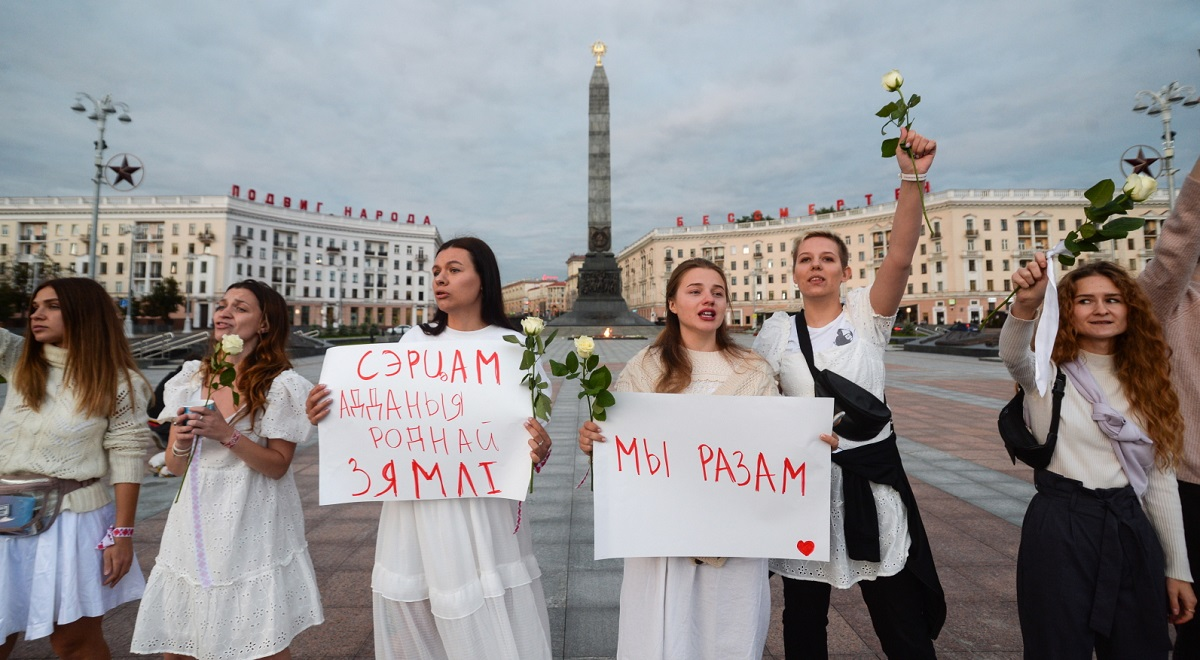 Women attend a rally in Minsk, Belarus, on Wednesday to support detained and injured participants of protests after the country's contested presidential election. Photo: EPA/YAUHEN YERCHAK