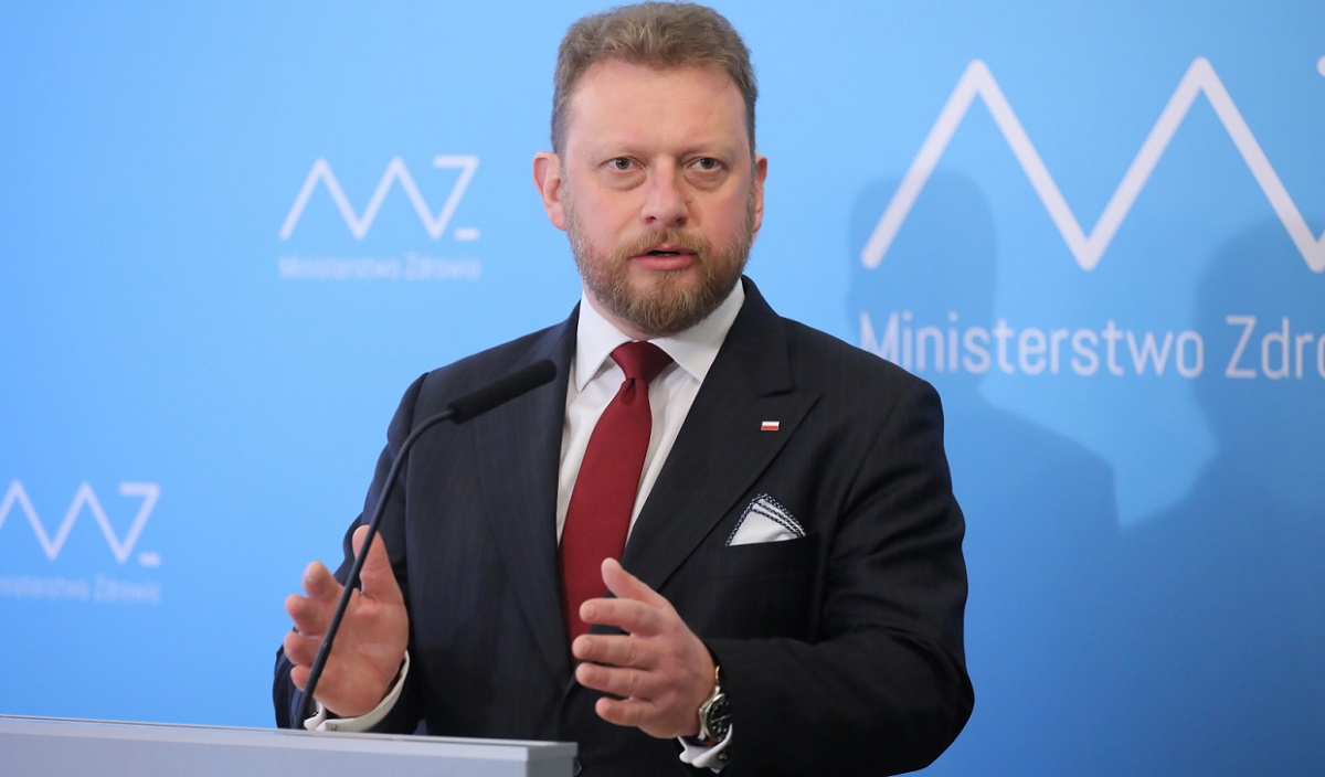 Polish Health Minister Łukasz Szumowski holds a news conference in Warsaw on Wednesday.