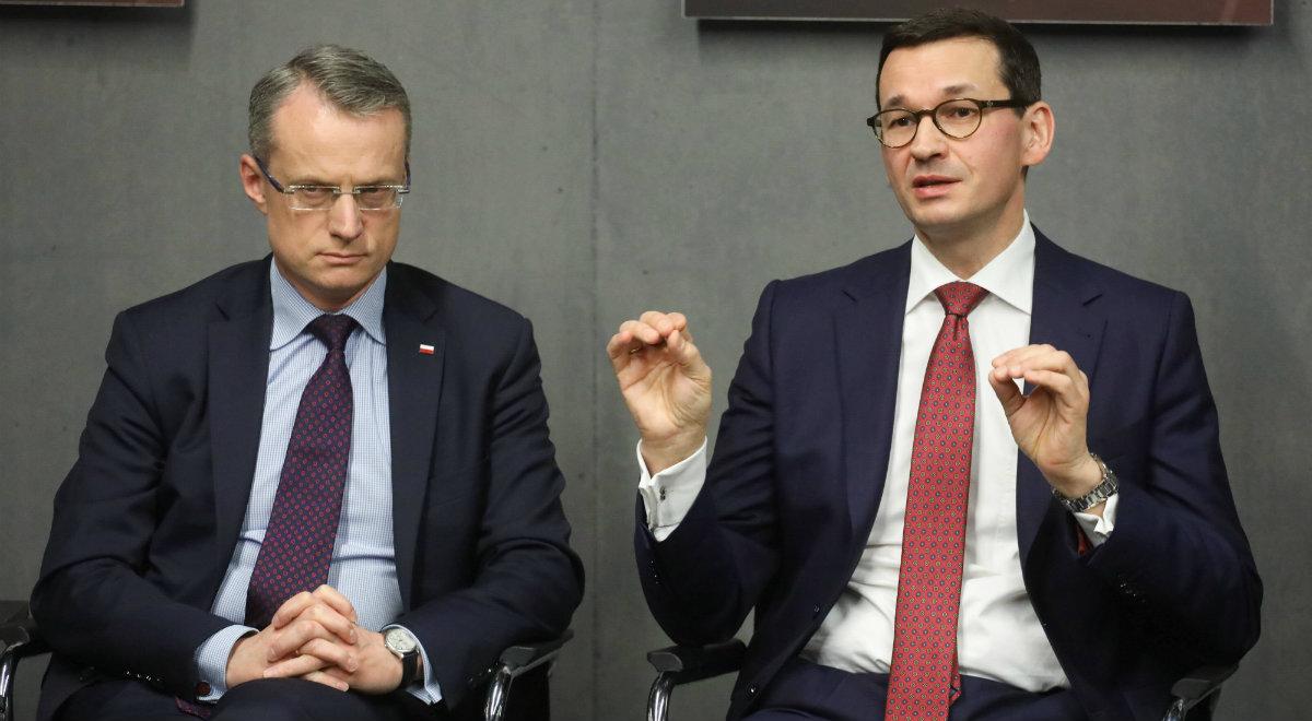 Premier Mateusz Morawiecki i polski ambasador Marek Magierowski