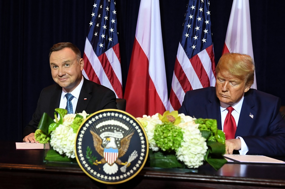 Andrzej Duda (left) and Donald Trump (right) sign the military agreement in New York on Monday.