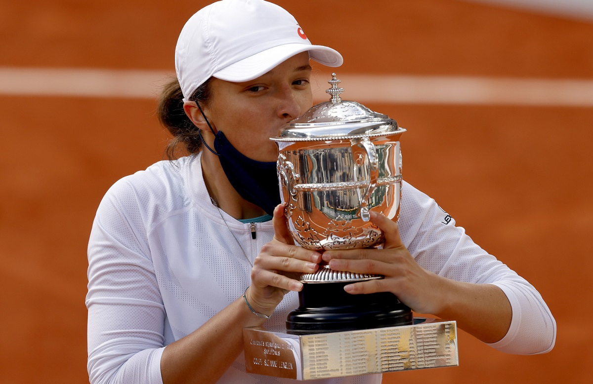 Poland's Iga Świątek celebrates with the trophy after winning the French Open on Saturday, Oct. 10, 2020.
